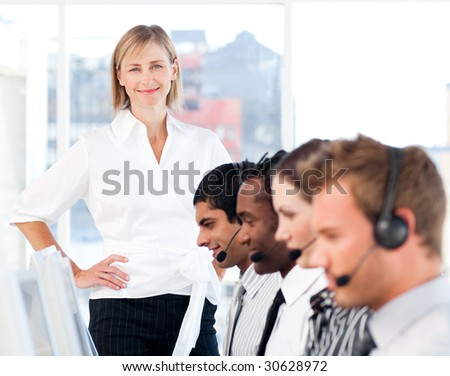 Senior Woman showing leadership in business - stock photo