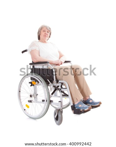 Senior woman sitting in wheel chair. All on white background - stock photo