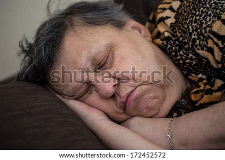senior woman sleeping - stock photo