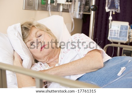 Senior Woman Sleeping In Hospital Bed - stock photo