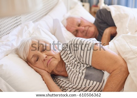 a man sleeping behind a woman naked