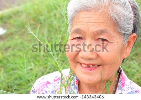 Senior woman smile - stock photo