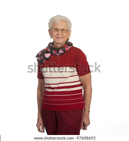 Senior woman standing. Shot against white background. - stock photo
