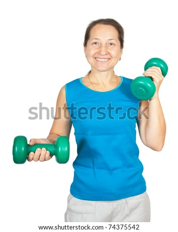 Senior woman staying fit by training her bicep muscles with green weights - stock photo