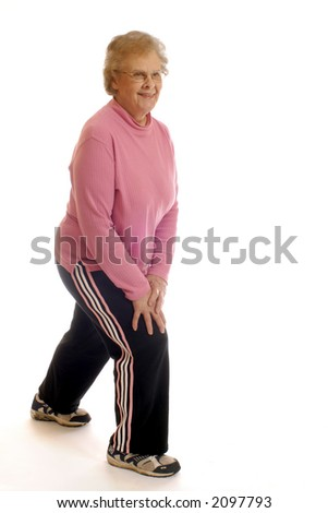 Senior woman stretching muscles before/after working out.  Isolated on white. - stock photo