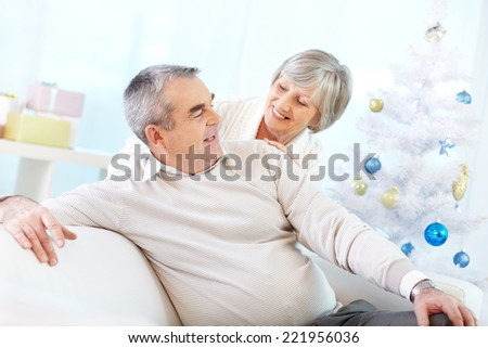 Senior woman stroking her husband - stock photo