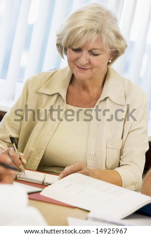 Senior woman studying on campus