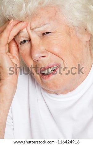 Senior woman suffering from headache - stock photo