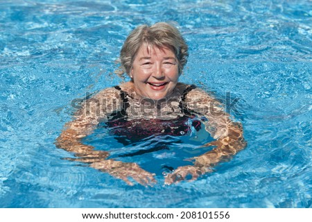 Senior Woman Swimming - stock photo