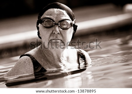 Senior Woman Swimming in Pool. Vintage Look.