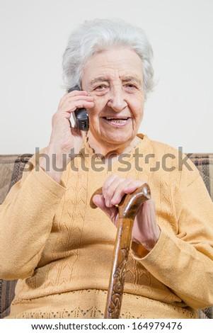 senior woman talking on phone - stock photo