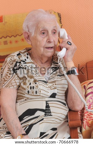 senior woman talking on the phone in a  retirement facility