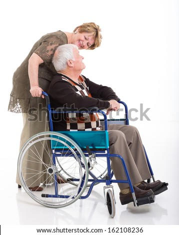 senior woman talking to her disabled husband isolated on white - stock photo