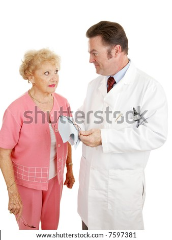 Senior woman talking with her optometrist as he cleans her new glasses.  Isolated on white.
