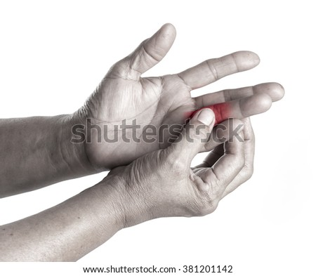 Senior woman touching her injured finger on white background,suffering pain concept - stock photo