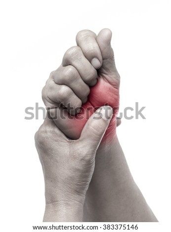 Senior woman touching her injured wrist on white background,suffering pain concept - stock photo