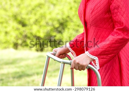 Senior woman using a walker - stock photo