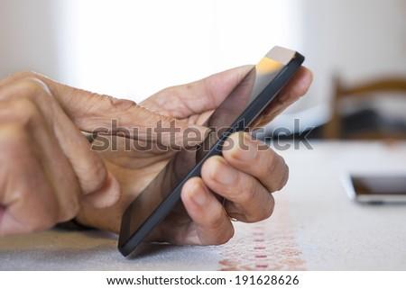 Senior woman Using mobile phone indoors  - stock photo