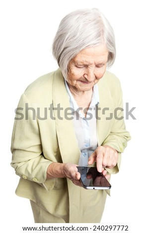 Senior woman using mobile phone while standing over white background - stock photo