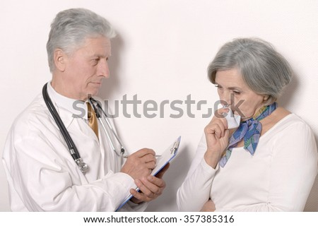 Senior woman visiting doctor at hospital  on white background