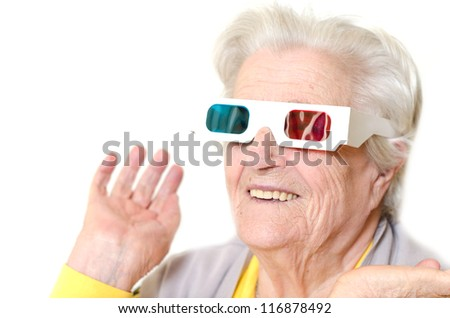 Senior woman wearing 3d glasses isolated on white background - stock photo