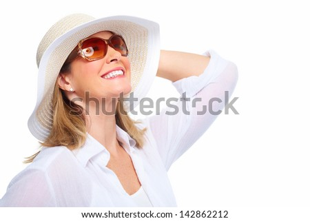 Senior Woman wearing sunglasses and a hat. Summer vacation. - stock photo