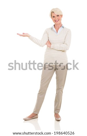 senior woman welcome gesture on white background - stock photo
