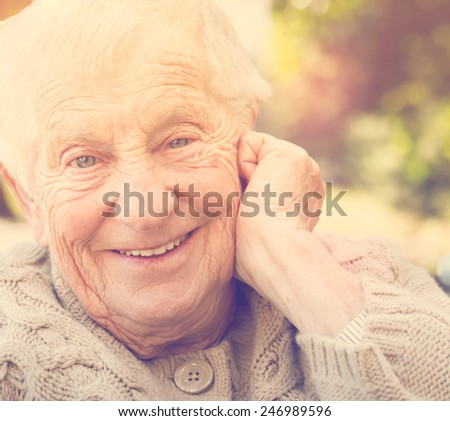 Senior woman with a big happy smile outside - stock photo
