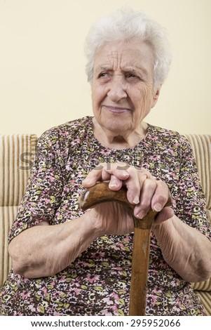 senior woman with cane - stock photo