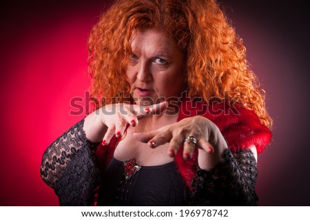 Senior woman with crazy look - stock photo