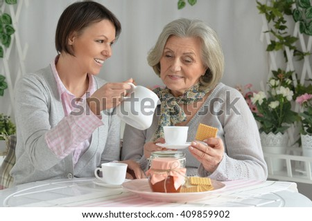 Senior woman with daughter  with tea