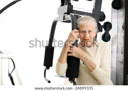 Senior woman with fitness machine over white background. Shallow DOF. - stock photo