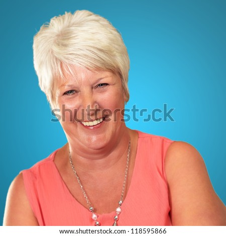 Senior Woman With Hands Crossed Isolated On Blue Background - stock photo