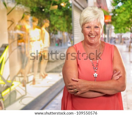 Senior Woman With Hands Crossed, Outdoor - stock photo