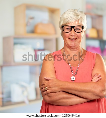 Senior Woman With Hands Folded, Indoor - stock photo