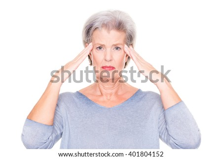Senior woman with headache in front of white background - stock photo