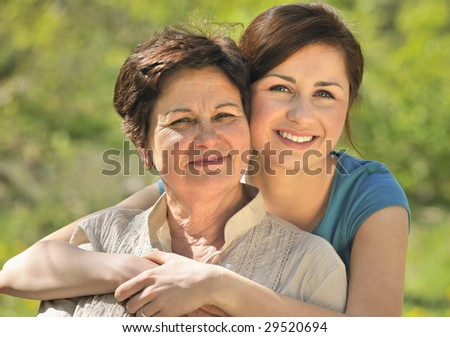 senior woman with her granddaughter outdoors - stock photo