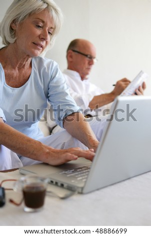 Senior woman with laptop computer
