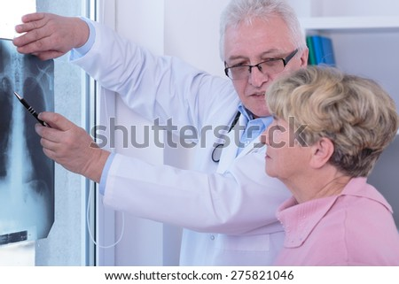 Senior woman with lung cancer during medical visit - stock photo