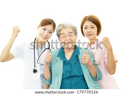 Senior woman with medical staff - stock photo