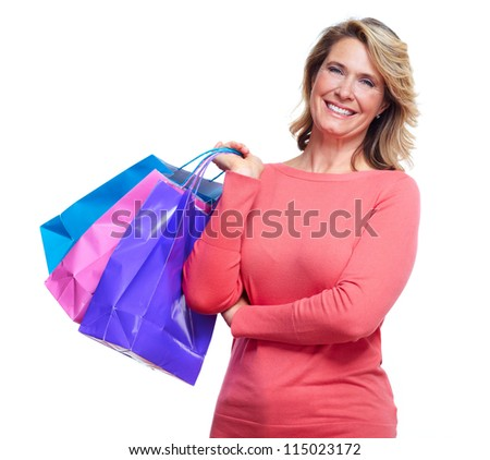 Senior woman with shopping bags. Isolated over white background. - stock photo