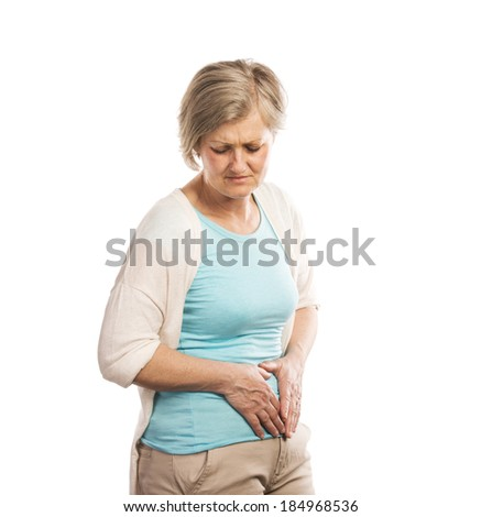 Senior woman with stomachache, isolated on white background - stock photo