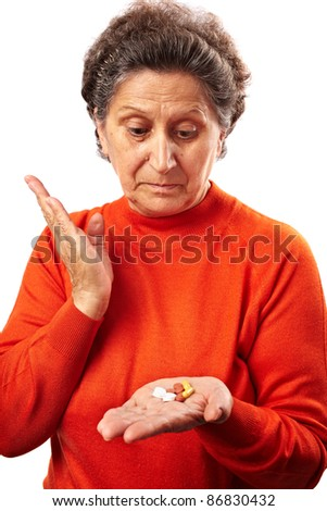 Senior woman worried about drug abuse, having to take too many pills - stock photo