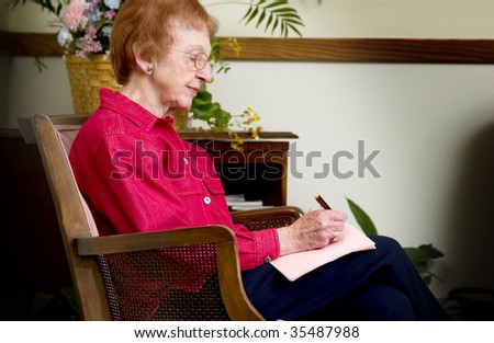 senior woman writing letter - stock photo