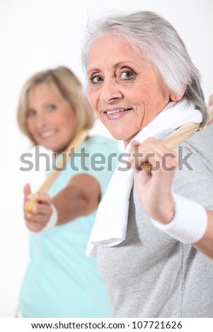 Senior women doing gymnastics - stock photo