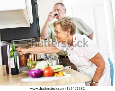 seniors cooking in kitchen at home - stock photo