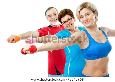 Seniors doing fitness exercises with help of trainer at sport gym - stock photo