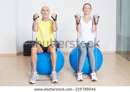 Seniors fitness exercise - stock photo
