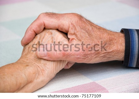seniors holding hands in happy atmosphere - stock photo