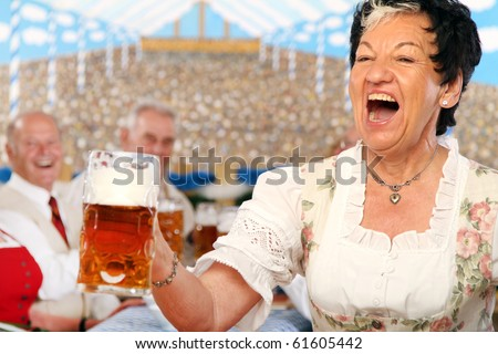 Seniors in a beer-tent - stock photo